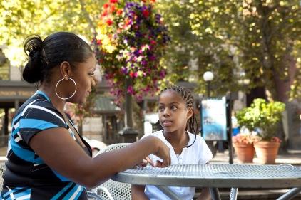 volunteer with girl outside